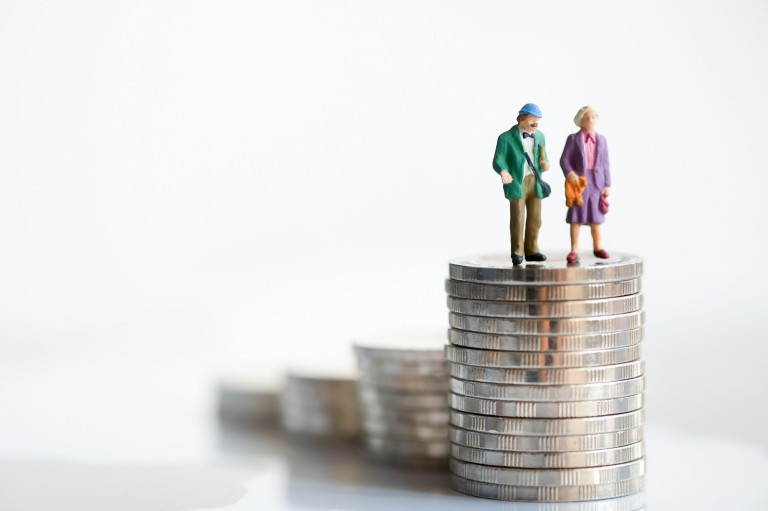Miniature,People:,Old,Couple,Figure,Standing,On,Top,Of,Stack